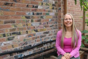 Ecology mortgage borrower with recycled bricks for sustainable self-build